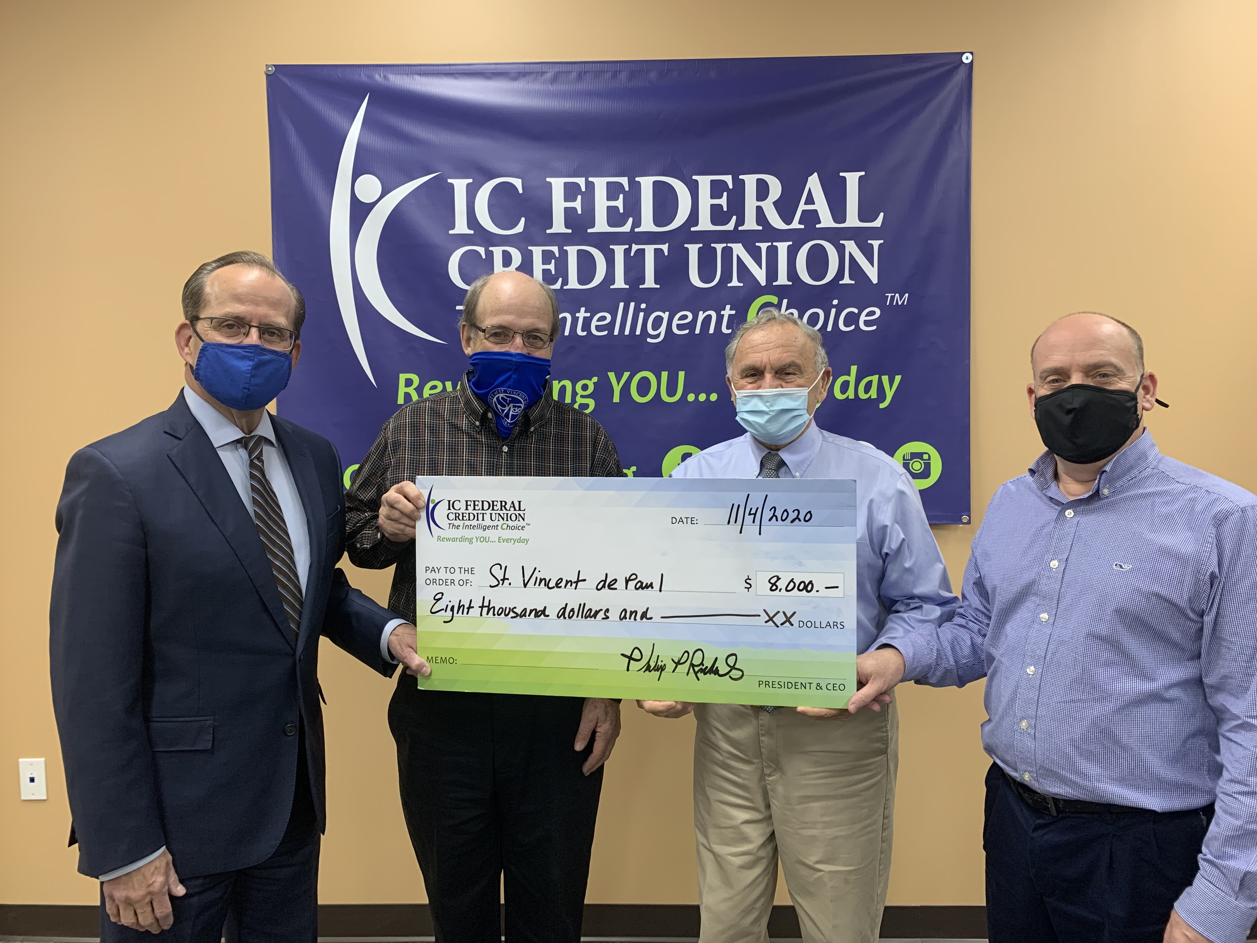 (l to r) – Phil Richards, President/CEO of IC; Roger Boisvert, President of the St. Vincent de Paul; Norman Boudreau, former President/CEO of IC; and Jim Hirst, SVP of IT at IC.
