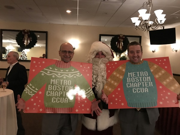 "Alan DeToma, Santa, Carlin Campbell from PW Campbell in their ""sweaters"""