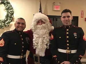 Santa and 'Holiday Heroes' - Marines collecting Toys for Tots at the chapter meeting.