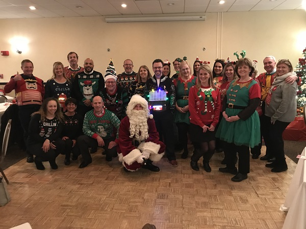 A bouquet of ugly sweaters brought holiday cheer at the Metro Boston Chapter meeting Tuesday night at Florian Hall!
