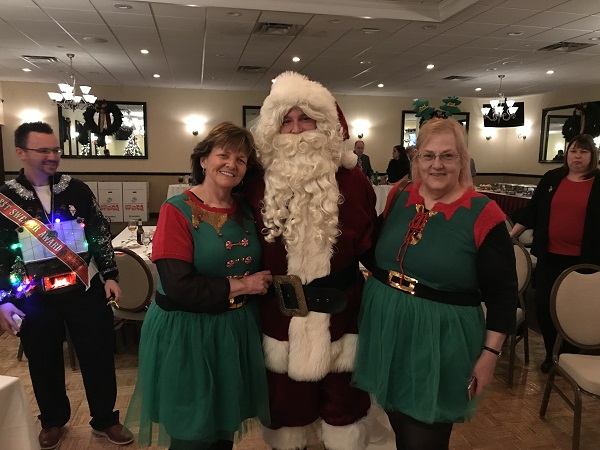 From left:  Jason Lasko, first prize winner: Elf Susan Connolly, City of Boston; Santa; Elf Cindy McBurnie, Members Plus