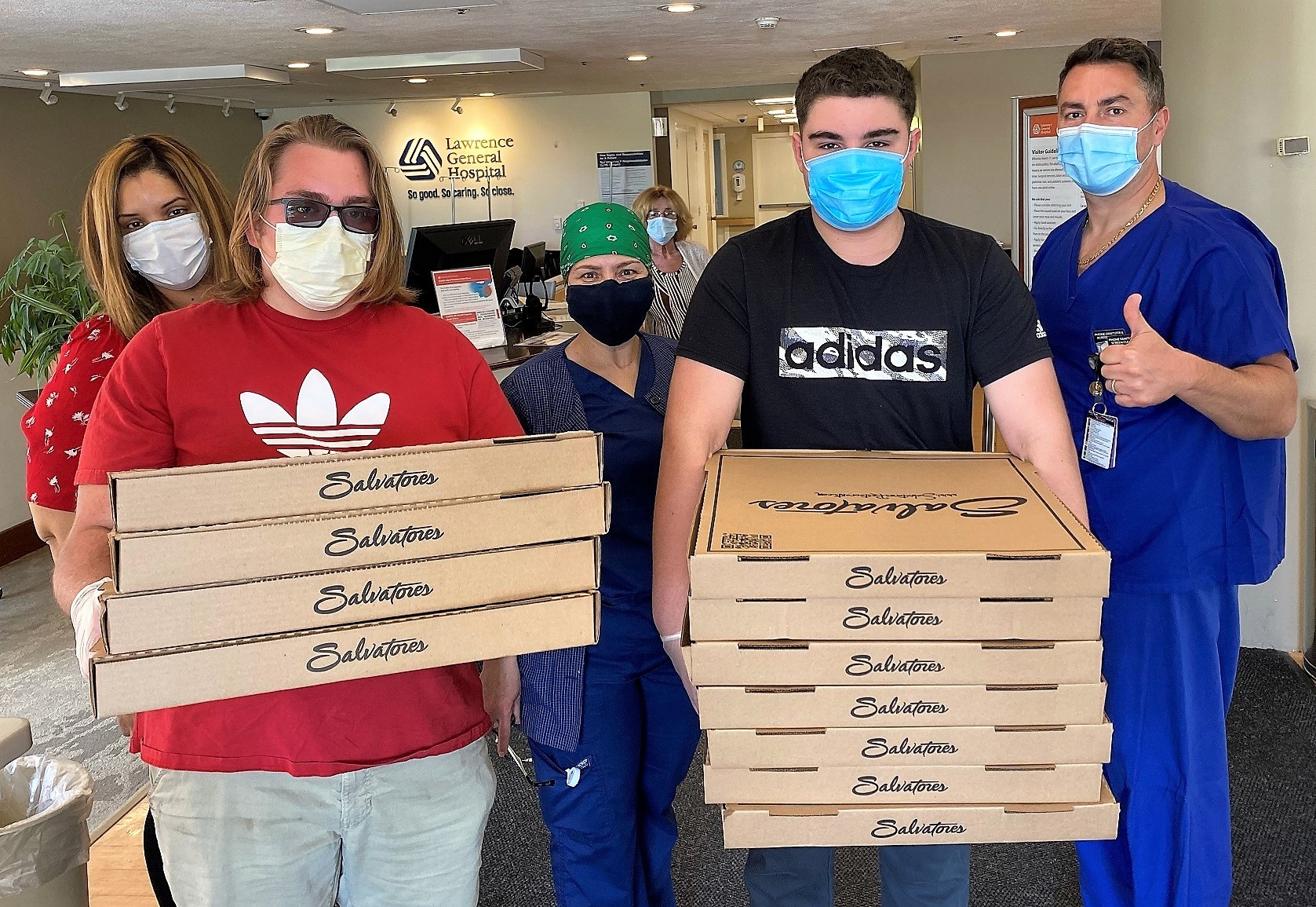 Employees from Salvatore's in Lawrence deliver 130 pizzas to staff at Lawrence General Hospital as part of Merrimack Valley Credit Union's 'Feed the Frontline' program.