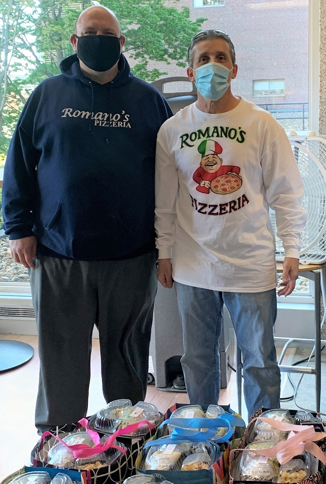 Manny Francisco and Chris Jarbeau, owners of Romano's Pizzeria in Lawrence, deliver meals to Lawrence General Hospital as part of Merrimack Valley Credit Union's 'Feed the Frontline' program.