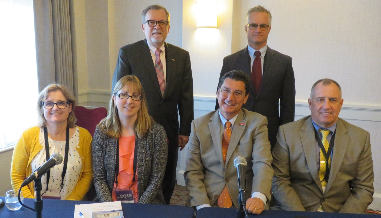 (L-R, sitting) Jill Carr, Andrea Cipolla, Michael Festa, and Thomas Quinn. (L-R, Standing) Walter Laskos and Barry Armstrong.
