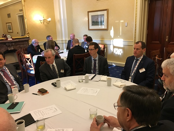 Jay Weismuller (center) from Senator Hassan's Office, discusses key credit union issues at New Hampshire Congressional Breakfast.